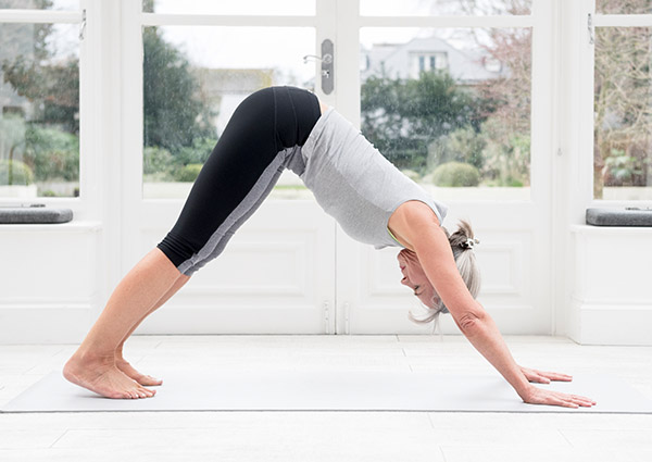 4 Yoga Poses and How They Benefit Your Body Downward-Facing Dog